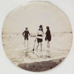 B/w photo from 1880 showing children on the beach